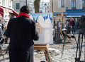 Painter painting and drawing in place du tertre in paris france Stock Photo