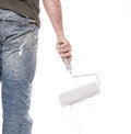 Painter worker one male house painting and priming wall with painting roller Royalty Free Stock Photos