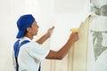 Painter worker peeling off wallpaper Royalty Free Stock Photo
