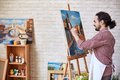 Painter working handsome in his studio Royalty Free Stock Photos