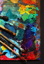 Painting brushes and palette studio photography of paint utensils on black background Stock Photo