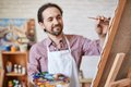 Painting on canvas male artist Royalty Free Stock Image