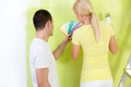 Painting couple choosing color from scale of samples swatches Stock Photo
