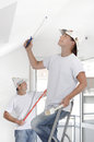 Painting couple indoor wall with dispersion Royalty Free Stock Photography