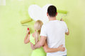 Painting couple new home together back view Stock Photo