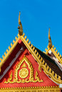 Painting craved front and top roof of budda temple Stock Photo