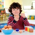 Painting easter eggs on the school adorable child Stock Photography