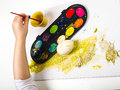 Painting egg little girls hands playing with colorful paint creating easter decoration Royalty Free Stock Photo