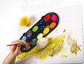 Painting egg little girls hands playing with colorful paint creating easter decoration Stock Image