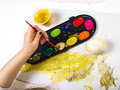 Painting egg little girls hands playing with colorful paint creating easter decoration Royalty Free Stock Photos