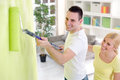 Painting home young cheerful couple their concept renovation Stock Image