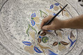 Painting of porcelain by hand. A traditional iznik Royalty Free Stock Photo
