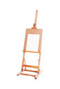 Painting stand wooden easel with blank canvas poster Royalty Free Stock Photo