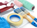 Painting tools on white background paint rollers brushes drop cloth masking tape and gloves Royalty Free Stock Photography