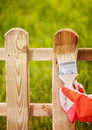 Painting wooden fence applying protective varnish to a Royalty Free Stock Image