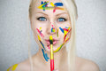 Paints blond girl with a brush Royalty Free Stock Photos