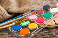 Paints and brushes oil to paint laid on the table in the composition Royalty Free Stock Photo