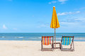Pair of beach chair with sun umbrella on beautiful beach concept for rest relaxation and holiday Stock Photography
