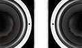 Pair of black audio speakers membrane closeup isolated on white background Royalty Free Stock Photography