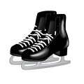Pair of black ice skates on white Royalty Free Stock Photos