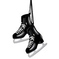 Pair of black ice skates on white Stock Photo