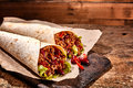Pair of Chili Stuffed Tex Mex Wraps on Wood Table Royalty Free Stock Photo