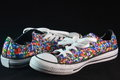 Pair of colorful sneaker worn out isolated on black background Royalty Free Stock Photo