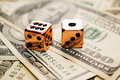 Pair of Copper Dice On Money Royalty Free Stock Photos