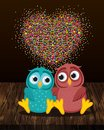 A pair of cute owls in love. Vector on wooden background. Colorful confetti in the form of heart. Greeting card or invitation for