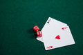 Pair of dice and playing cards on poker table Royalty Free Stock Photo