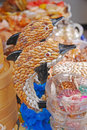 A pair of dolphin souvenirs made from shells local empty in tai o shop hong kong Stock Photos
