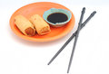 Pair of egg rolls with chopsticks Royalty Free Stock Photos