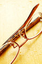 Pair of eyeglasses on wet wood table top Royalty Free Stock Photos