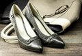 stock image of  Pair of female shoes and handbag isolated on a dark