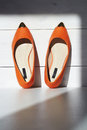 Pair of female summer shoe.orange girls shoes without heels Royalty Free Stock Photo