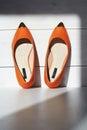 Pair of female summer shoe.orange girls shoes without heels Royalty Free Stock Photo