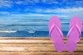 Pair Of Flip-flops Against Sea