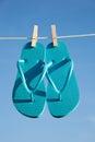 A pair of flipflops against a blue sky