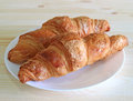 Pair of fresh whole wheat Croissant pastries served on a white plate Royalty Free Stock Photo