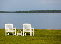 Pair of garden chairs by Chesapeake bay Royalty Free Stock Photos