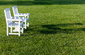 Pair of garden chairs on green lawn in garden Royalty Free Stock Images