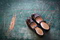 Pair of Girl Shoes on old blackboard Royalty Free Stock Photo