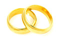 Pair of golden wedding rings on a white background Stock Photography