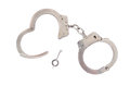 Pair of handcuffs photo a isolated on a white background Royalty Free Stock Images
