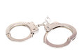 Pair of handcuffs photo a isolated on a white background Stock Images