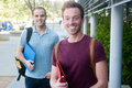 Pair of happy young male students on campus Royalty Free Stock Photos