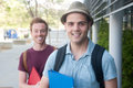 Pair of happy young male students on campus Stock Image
