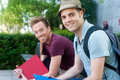 Pair of happy young male students on campus Stock Images