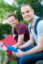 Pair of happy young male students on campus Royalty Free Stock Image