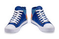 Pair of high top color denim gymshoes Royalty Free Stock Photo